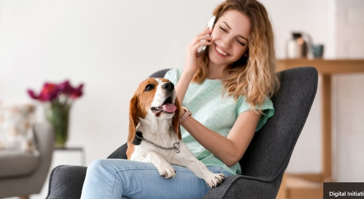 Woman talking on the phone with Beagle